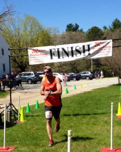 Bryan finishing strong at the half marathon in Foster
